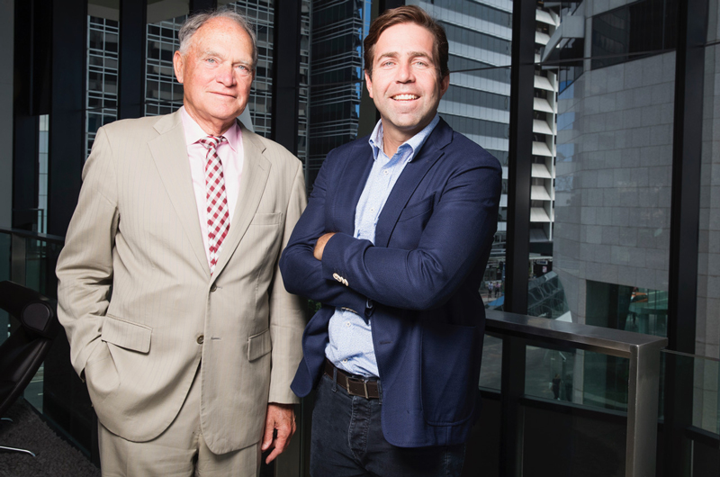 Fourth generation Dan White, beside father Brian, joined Ray White Group in 2000 after working at Macquarie Bank and Arthur Andersen